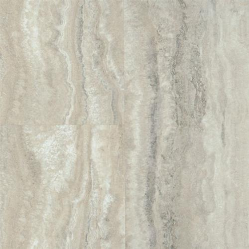 A close-up (swatch) photo of the Piazza Travertine   Dovetail flooring product