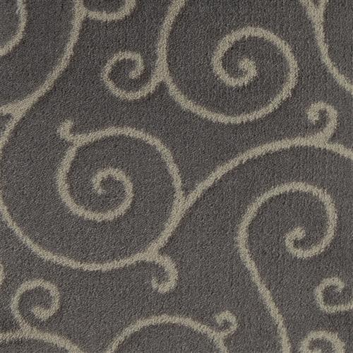 The clean and graceful lines of Traces accentuate the movement in this updated yet classic scroll design.